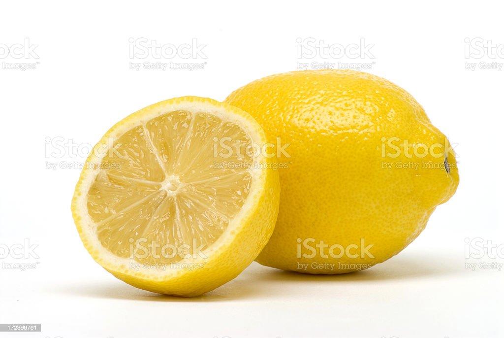 Arrangement of half lemon resting against a full lemon stock photo
