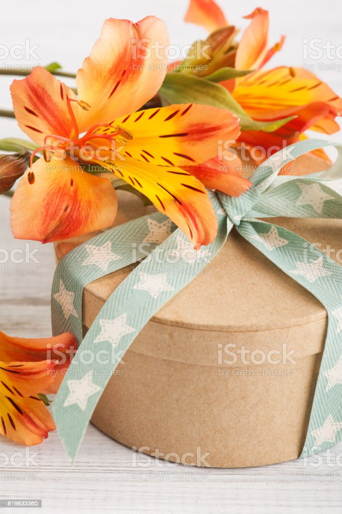Arrangement of orange lily flowers, gift box. Greeting card for...