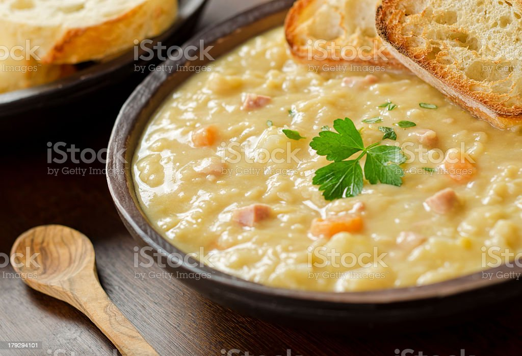 Arrangement of pea soup in bowl with toast stock photo