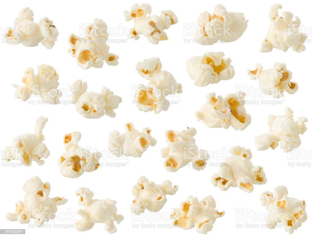 Arrangement of popcorn kernels isolated on white background stock photo