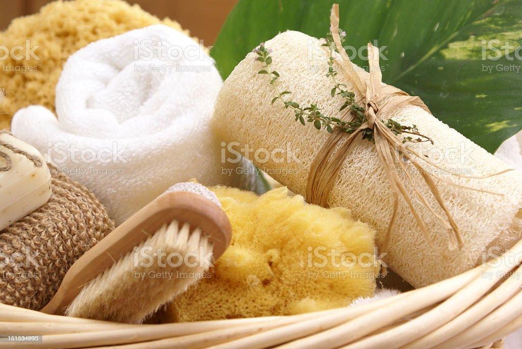 Arrangement of spa utensils in a wicker basket royalty-free stock photo