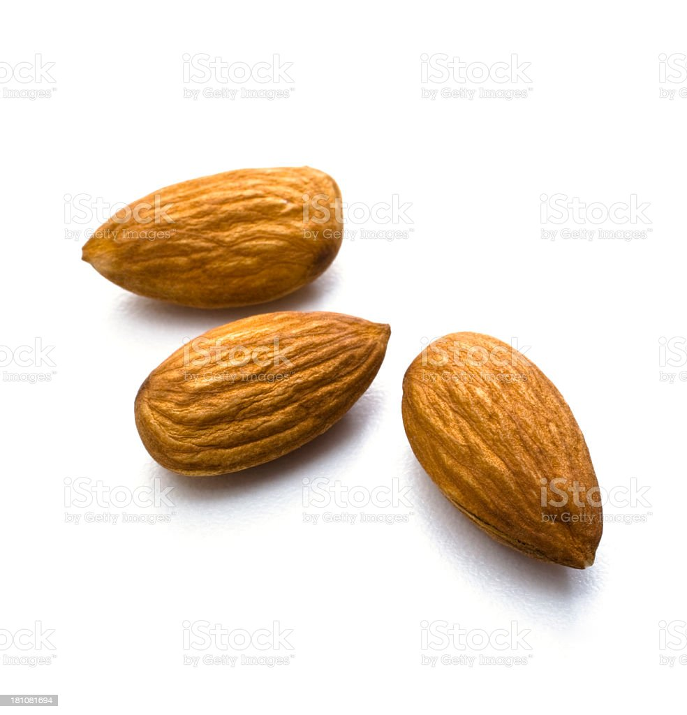 Arrangement of three almonds against white background stock photo