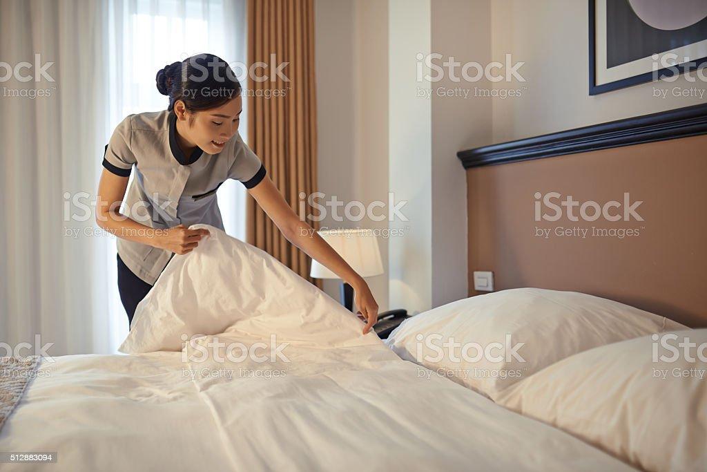 Arranging blanket stock photo