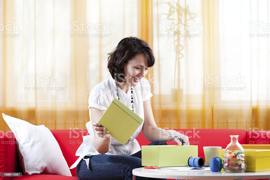 Arranging gifts, looking inside a box royalty-free stock photo