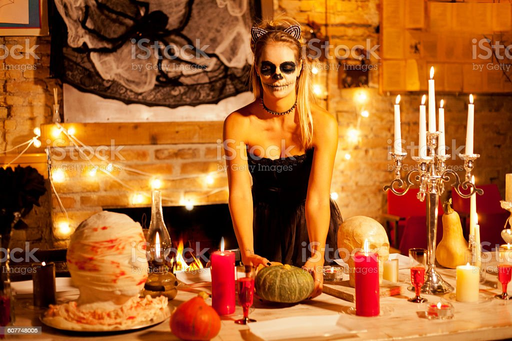 Arranging table for Halloween night stock photo