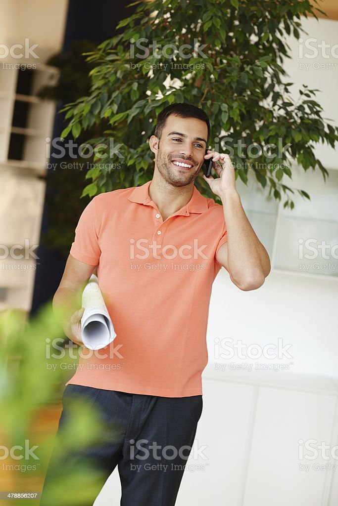 Arranging to deliver his client's plans stock photo