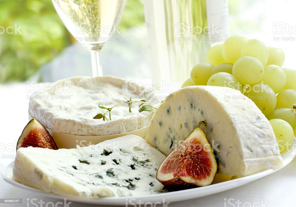 Array of cheese, grapes, figs and wine on table royalty-free stock photo