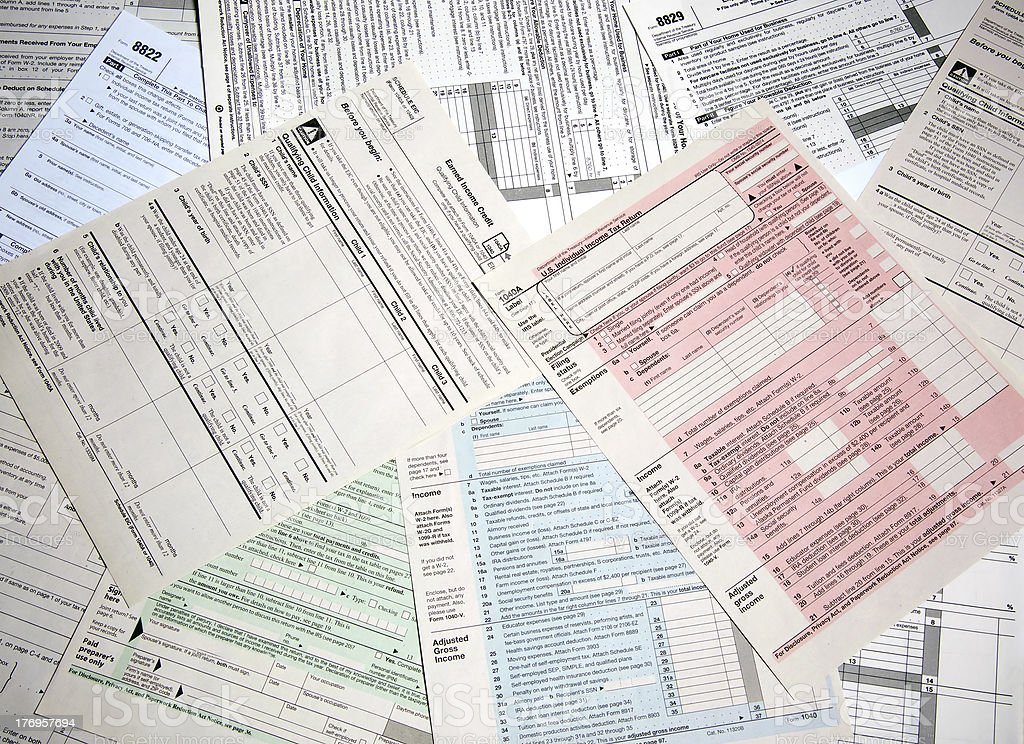 Array of income tax forms from the IRS stock photo