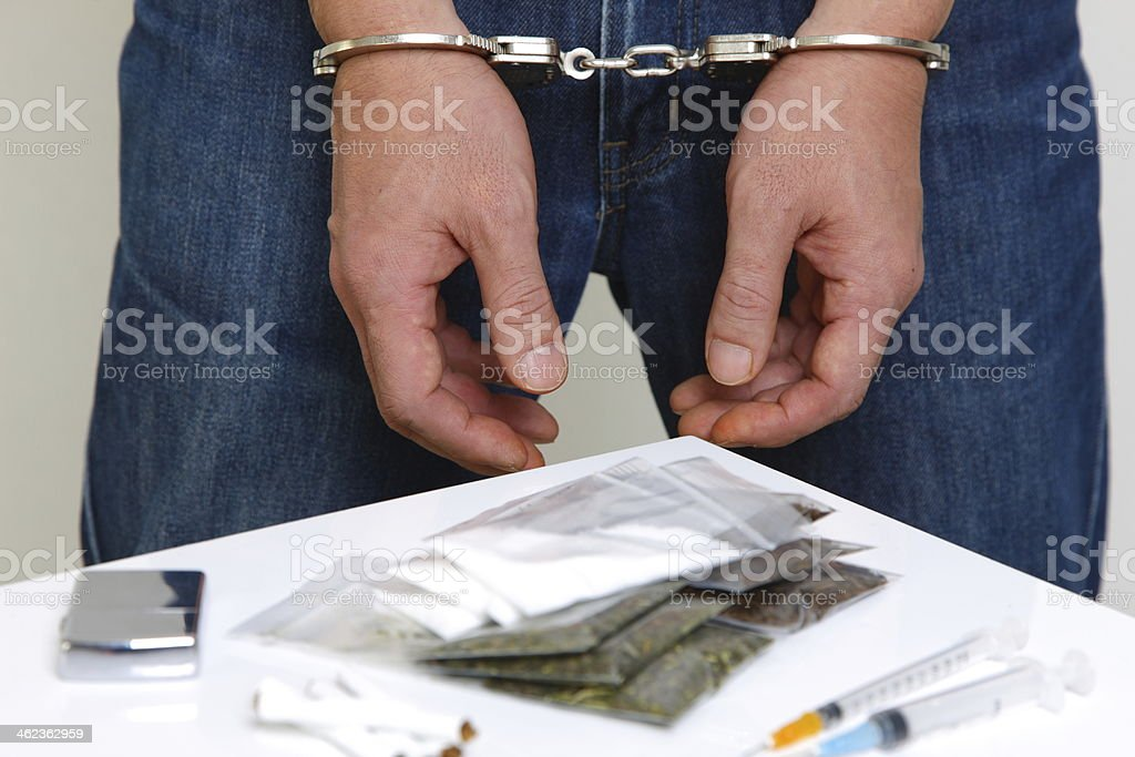 arrested drug dealer stock photo