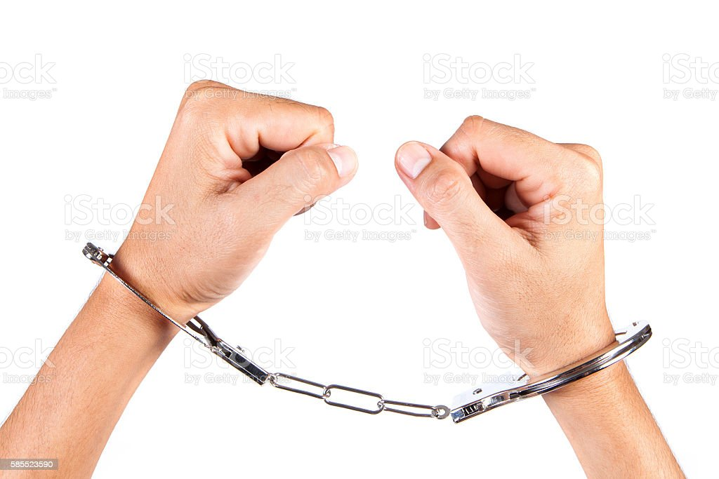 Arrested man in handcuffs isolate with white background. stock photo