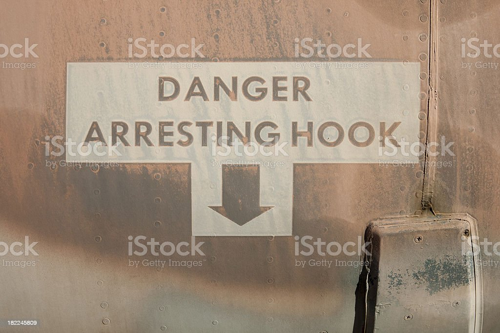 Arresting Hook Warning Sign for Aircraft Carrier Based Jet Plane royalty-free stock photo