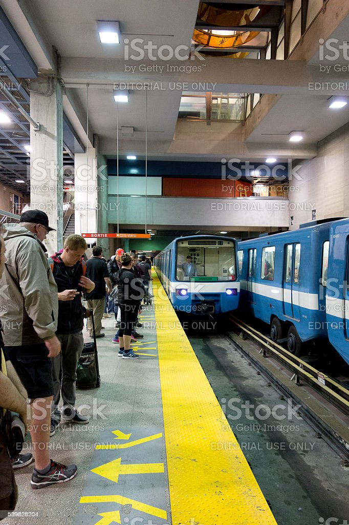 Arrival of a subway train on platform Montreal stock photo