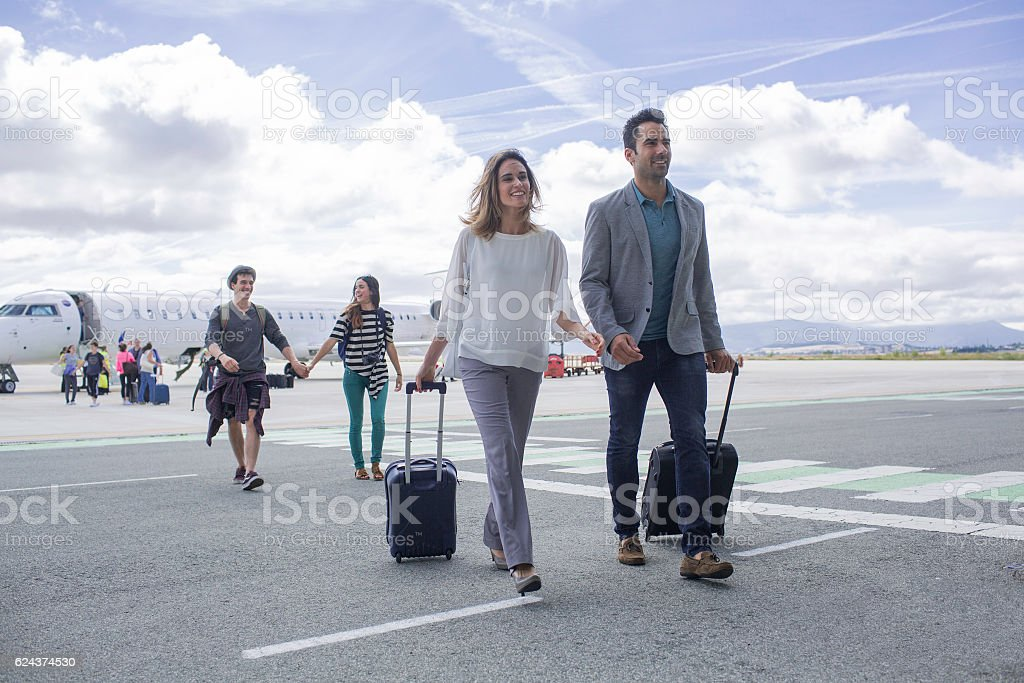 Arriving at the airpot, walking on the landing track. stock photo