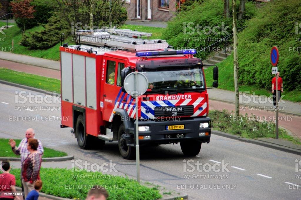 Arriving fire brigade stock photo