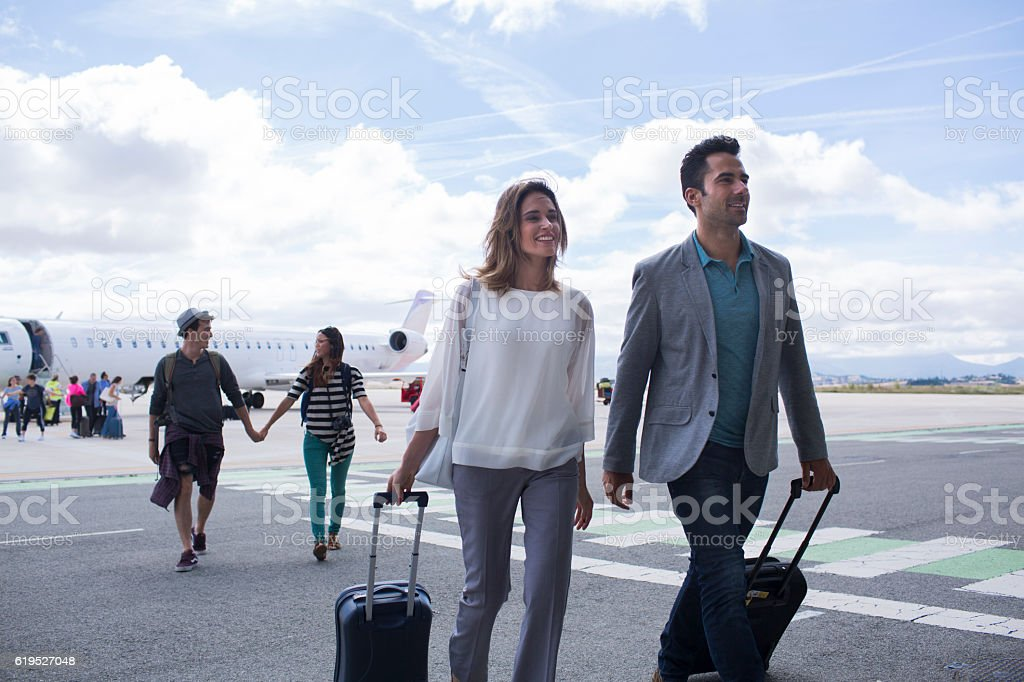 Arriving from a journey with airplane. stock photo
