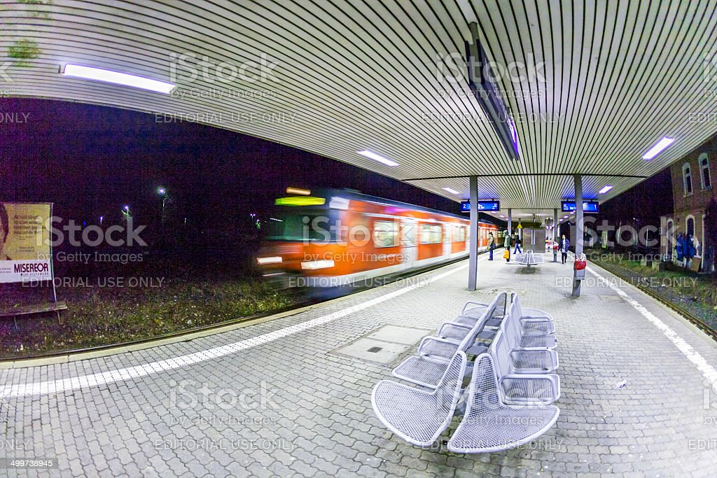 arriving train  at train station in early morning royalty-free stock photo