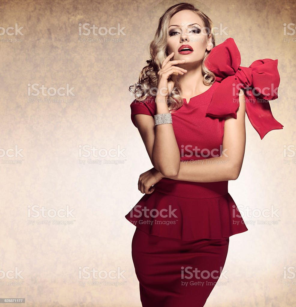 arrogant blond sexy girl. red dress stock photo