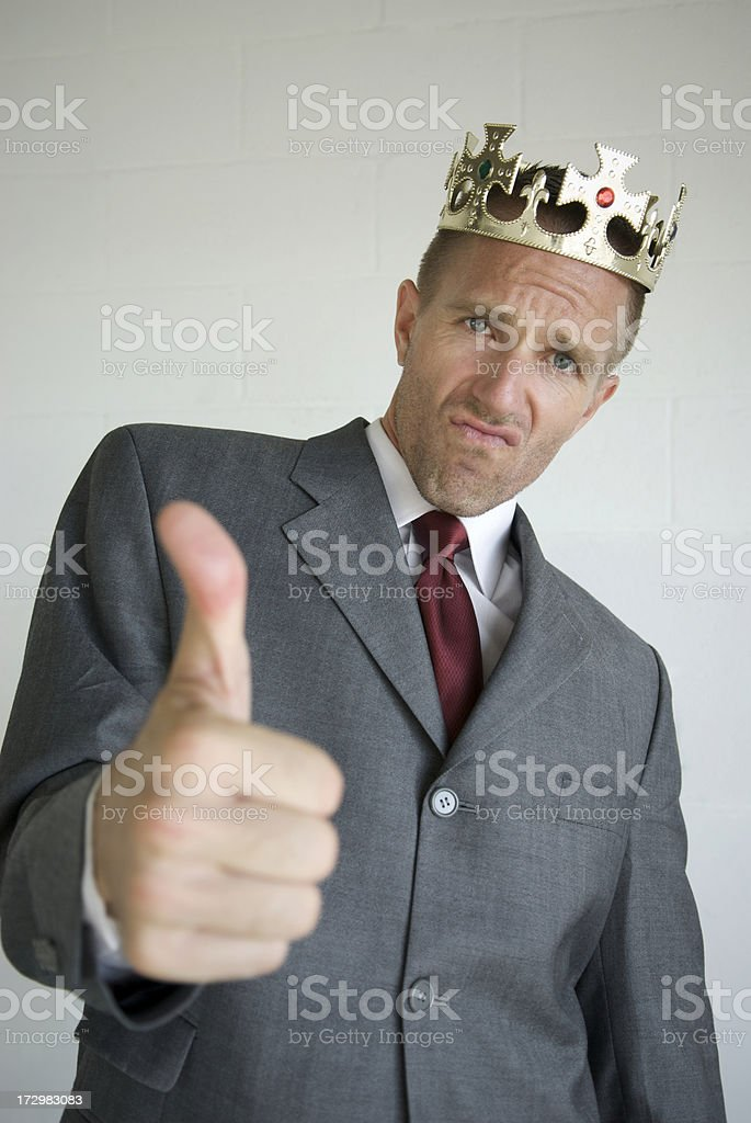 Arrogant Businessman with Crown Gives Thumbs Up royalty-free stock photo