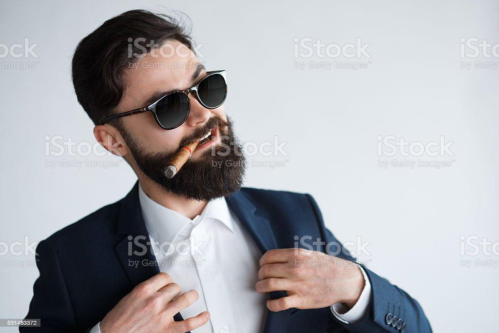 Arrogant rich bearded man in sunglasses stock photo