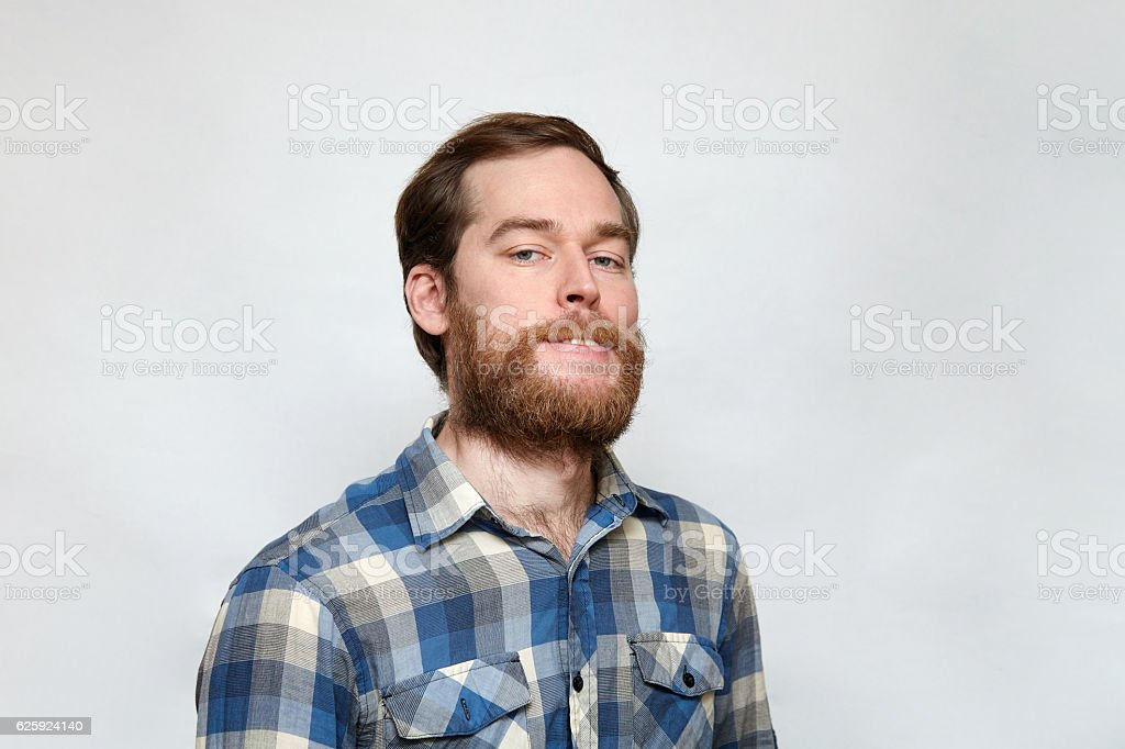 Arrogant toothy man with thick beard stock photo