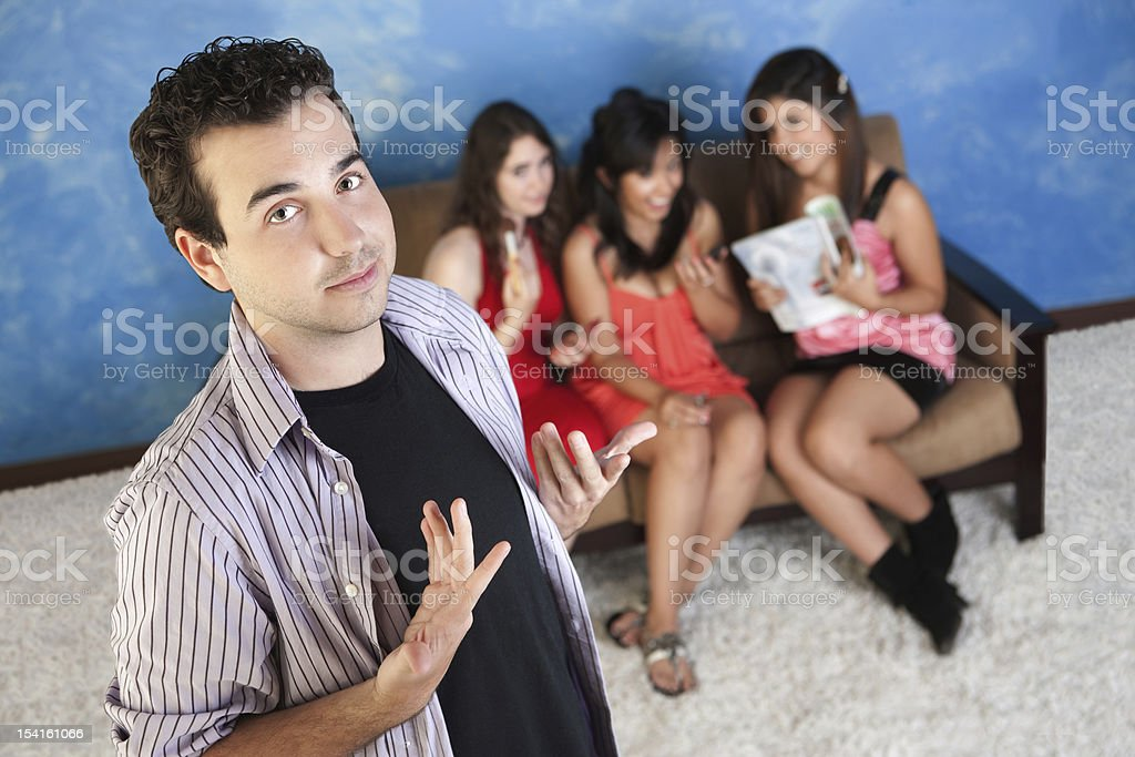 Arrogant Young Man With Girlfriends stock photo