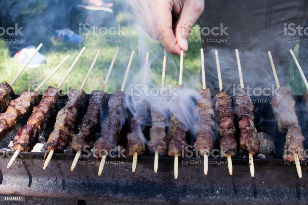 Arrosticini on the grill, Abruzzi skewers of sheep stock photo