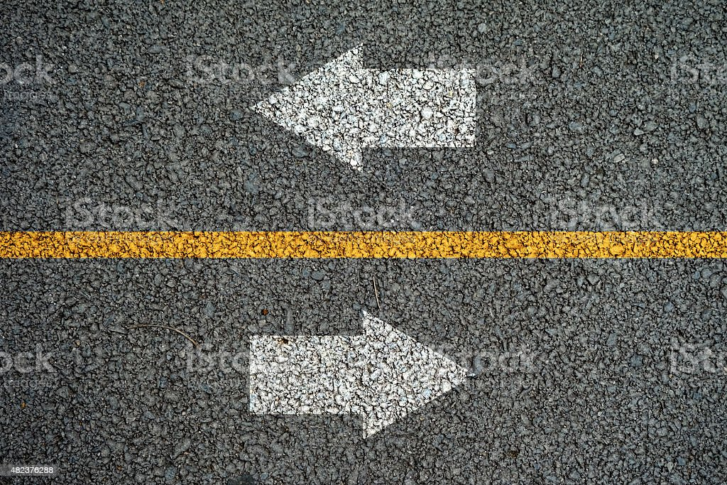 Arrow and line on the asphalt roads stock photo