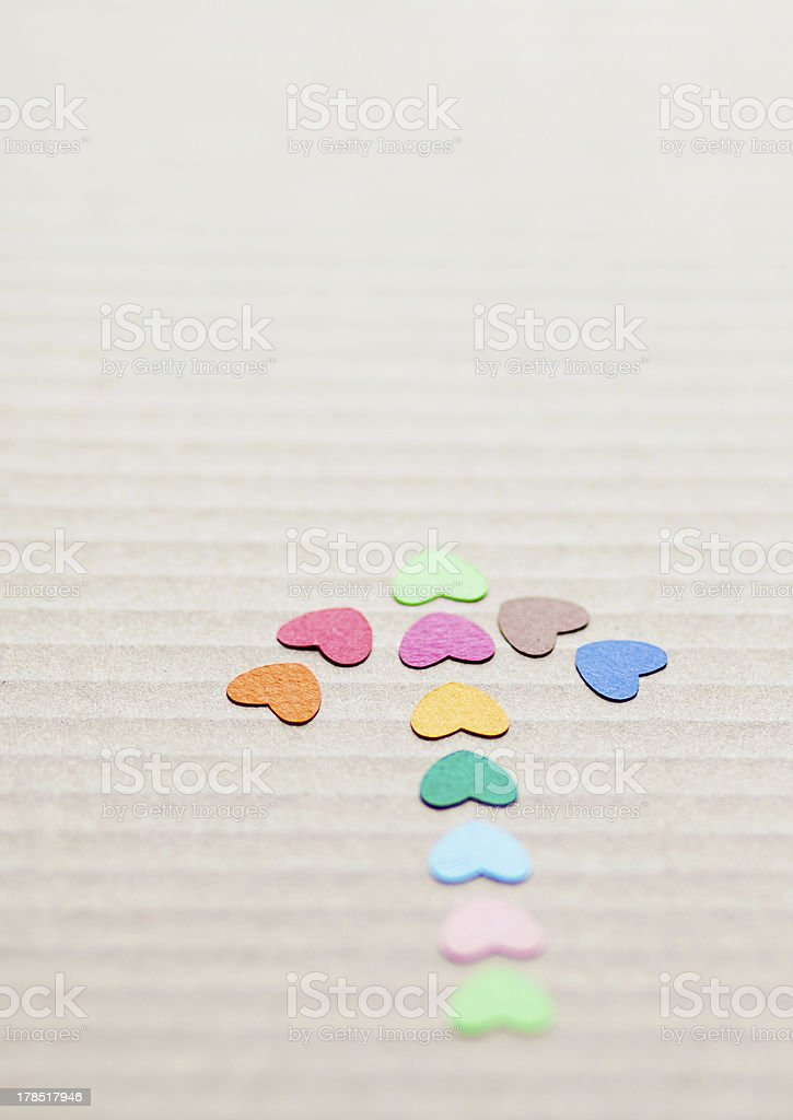 arrow from multicolored paper hearths royalty-free stock photo