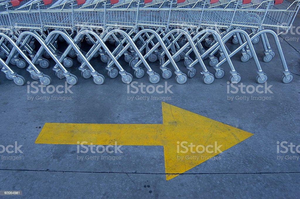 Arrow. Grocery carts. royalty-free stock photo