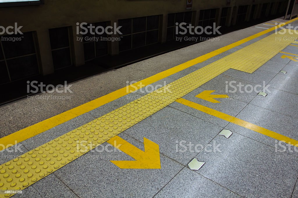 arrow in the subway station stock photo