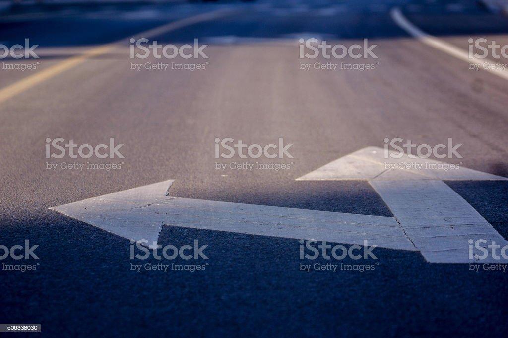 arrow in traffic lane stock photo
