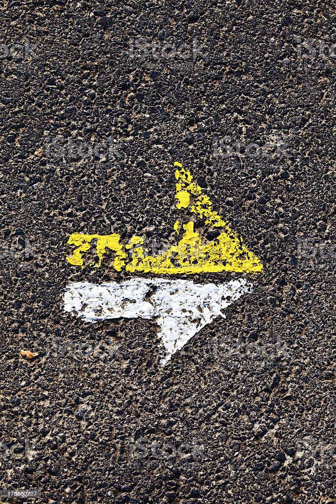 arrow in yellow and white on a paveway for orientation stock photo