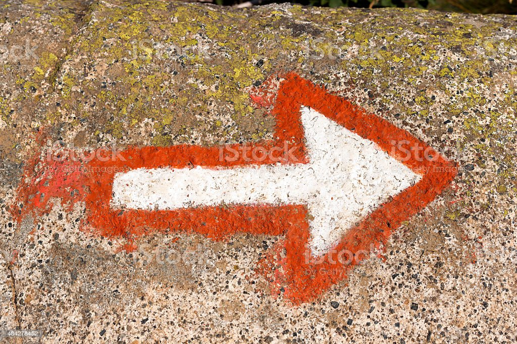 Arrow Marking a Mountaineering Path on a Rock stock photo