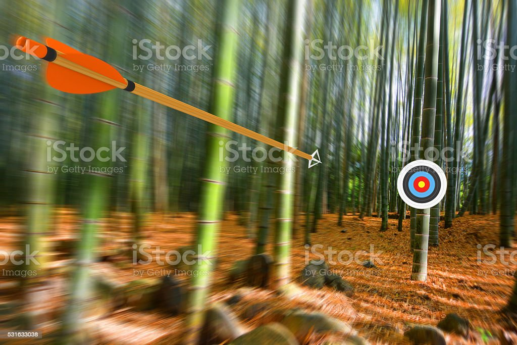 Arrow moving through air to target with radial motion blur stock photo