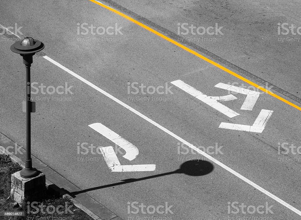 arrow on road - Stock Image stock photo