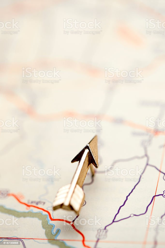 Arrow Pointing The Way On Road Map stock photo