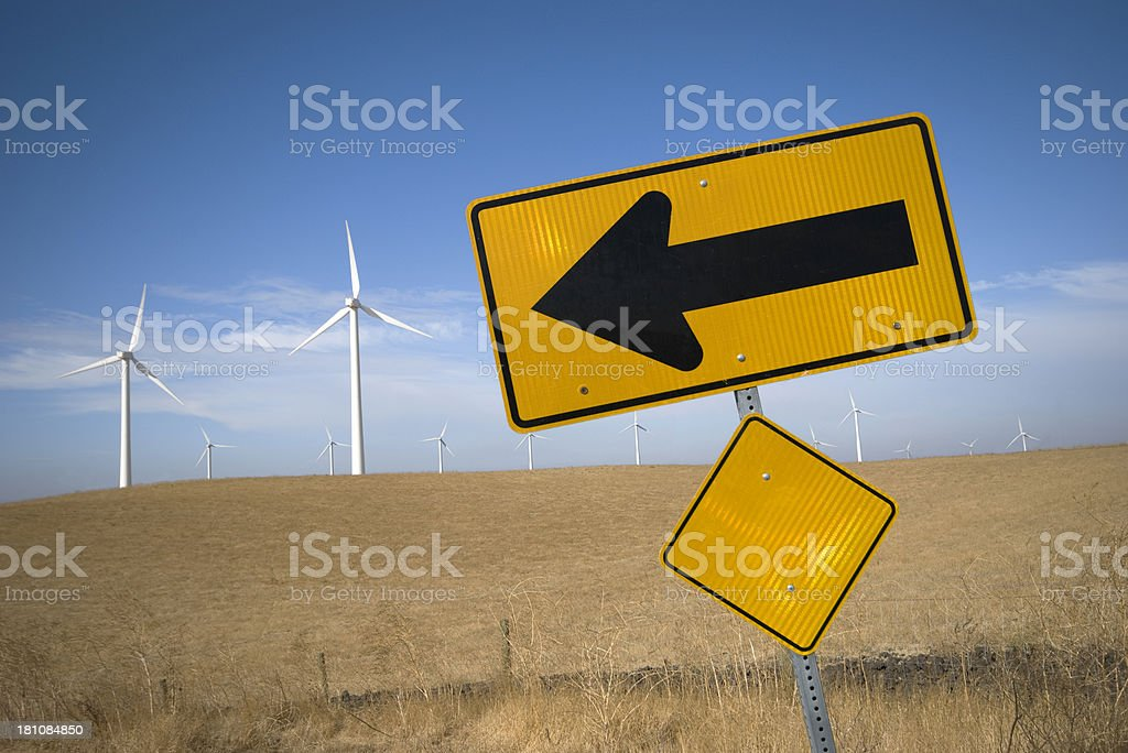 Arrow pointing to wind turbines generating electricity in California stock photo