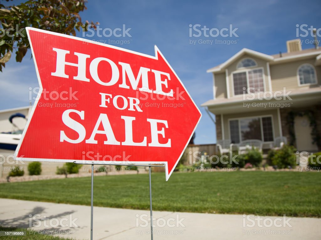 Arrow Shaped Home For Sale Sign stock photo