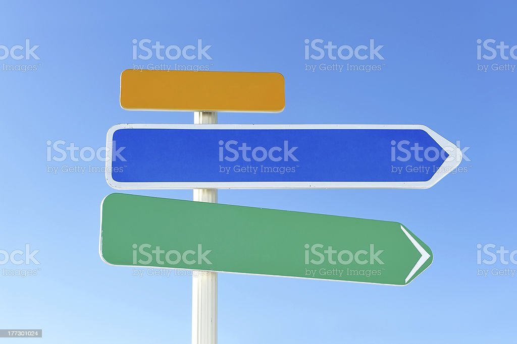 Arrow sign against sky royalty-free stock photo