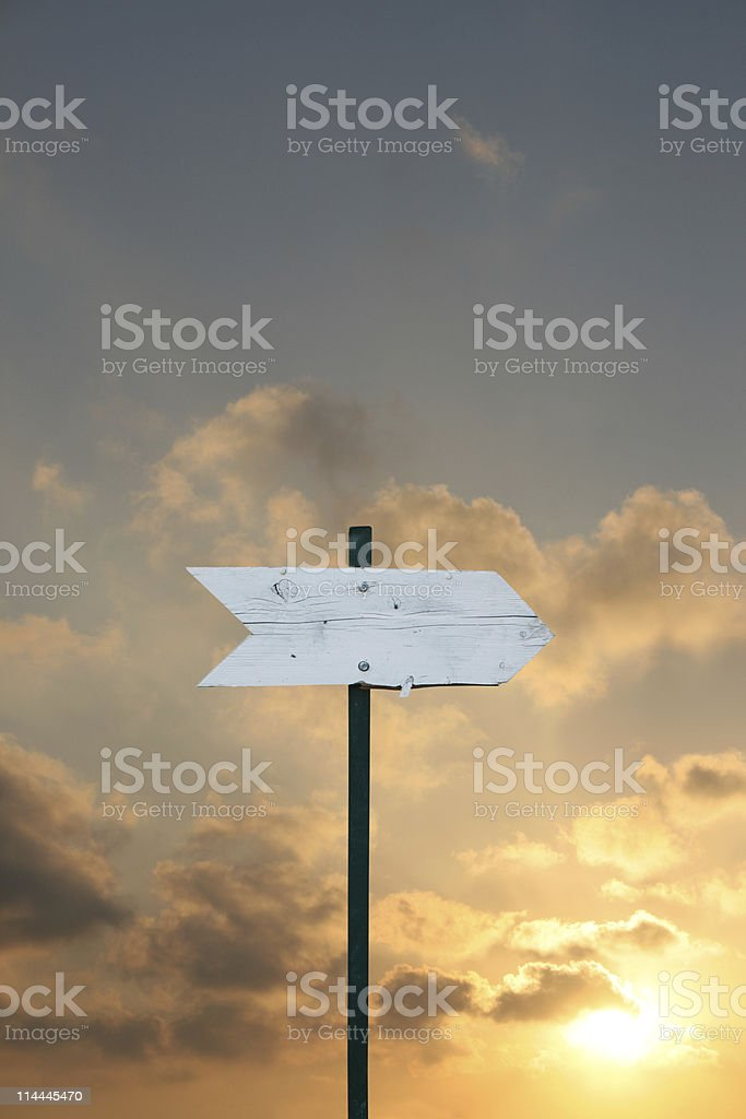 Arrow sign at sunset stock photo