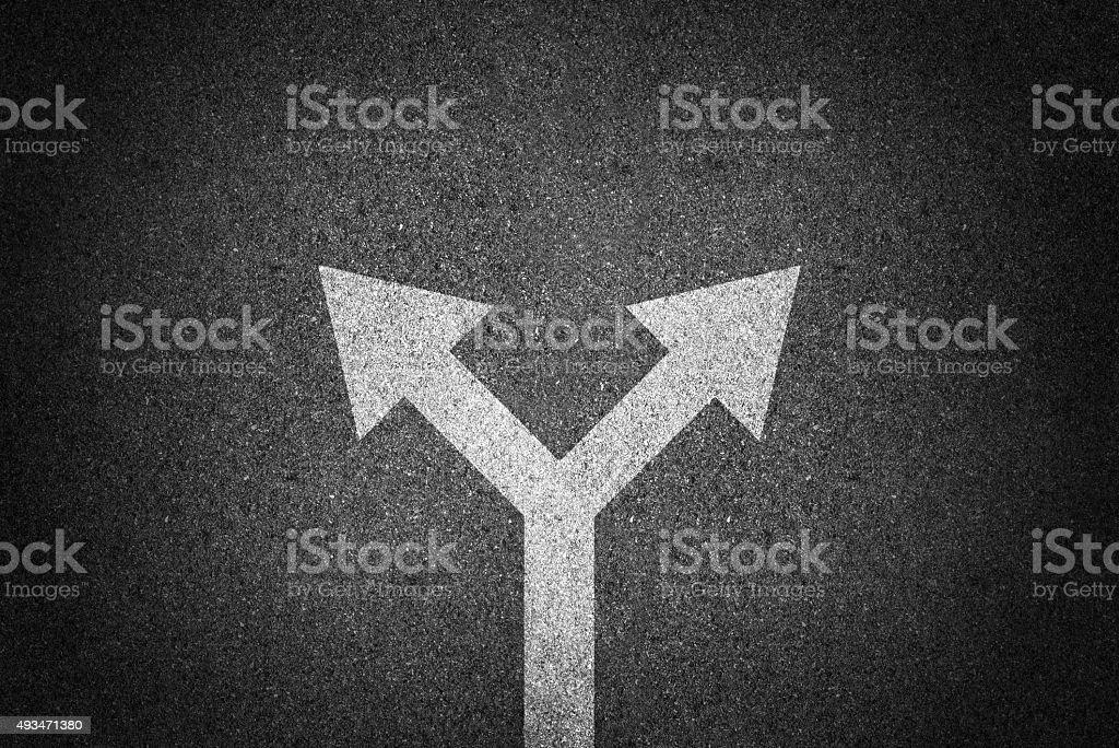Arrow sign direction on asphalt stock photo