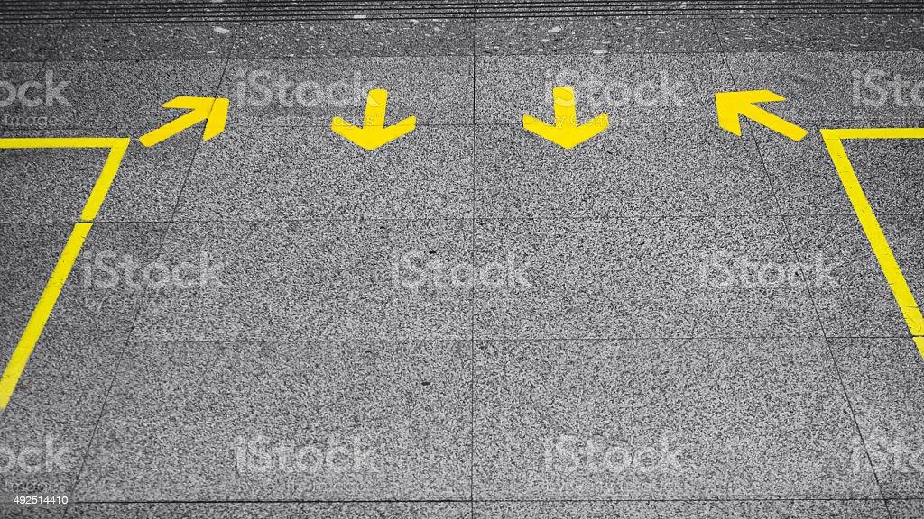 Arrow sign Direction on Floor stock photo