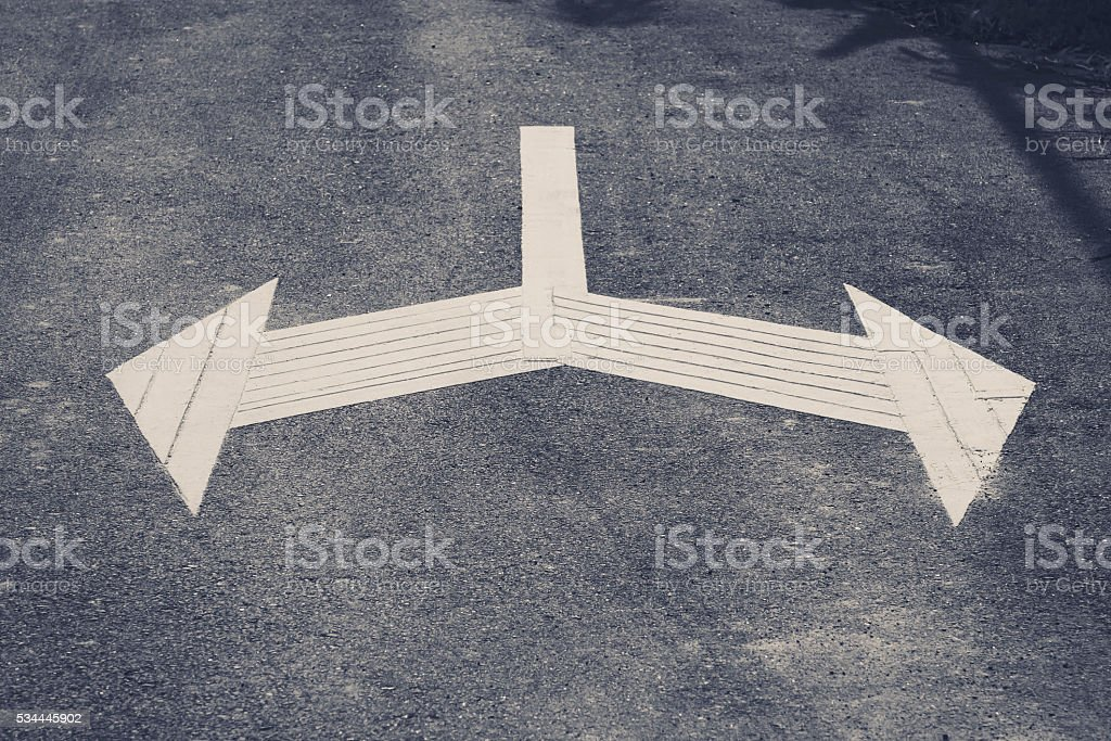 Arrow Sign direction on road Left and Right Traffic Signage stock photo