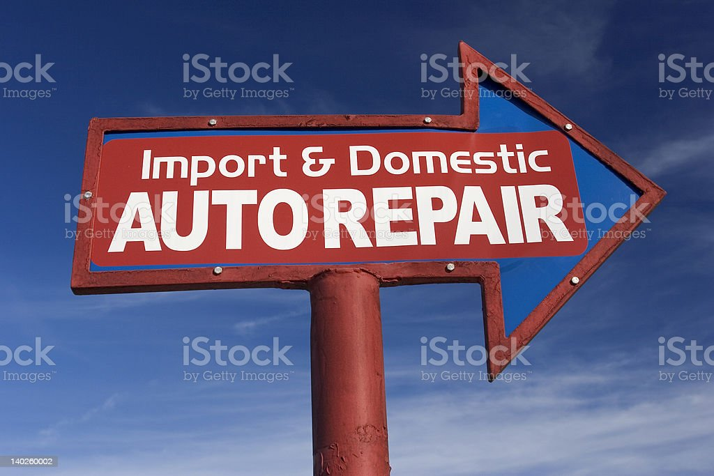 Arrow Sign for Auto Repair Shop royalty-free stock photo