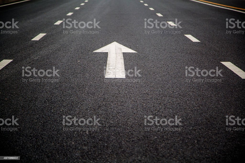 arrow sign in traffic lane stock photo