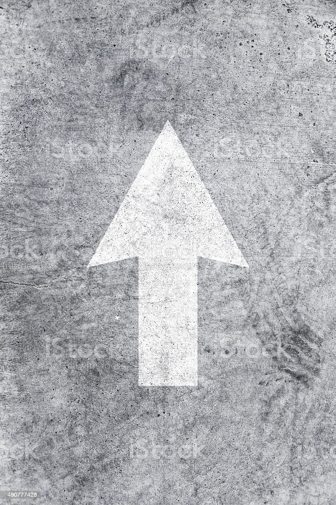 Arrow sign on asphalt stock photo