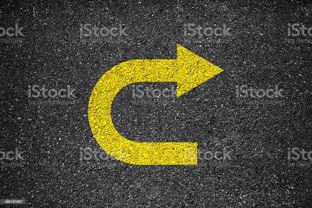 Arrow Sign On The Asphalt stock photo