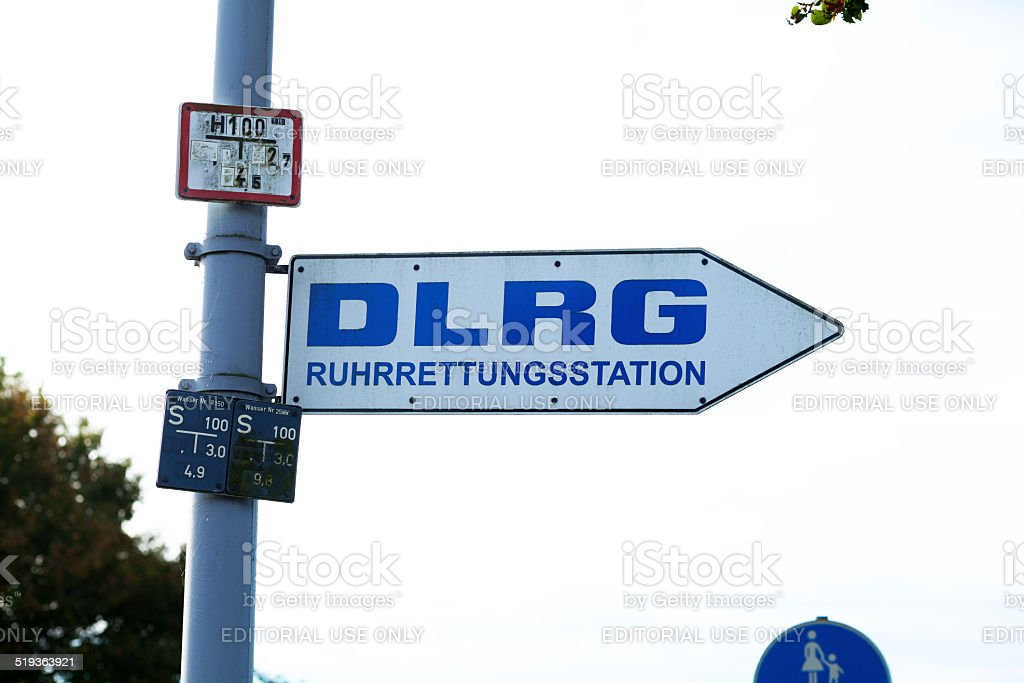 Arrow sign to DLRG rescue station at Ruhr stock photo