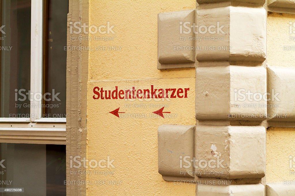 Arrow sign to Studentenkarzer in Heidelberg stock photo
