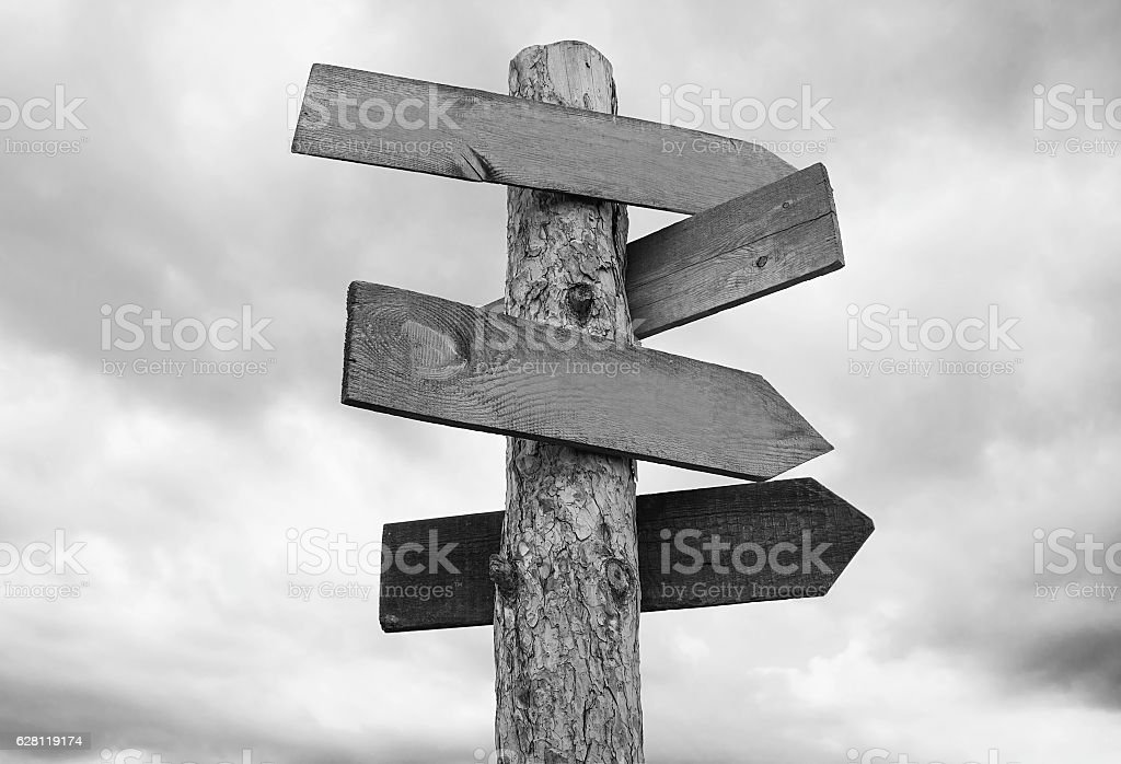 Arrow signboards on grey sky background stock photo
